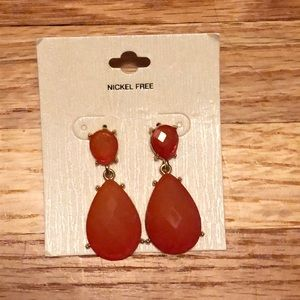 Salmon and gold colored fashion earrings